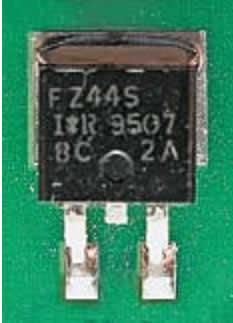 Внешний вид паяного соединения транзистора в корпусе SMD-220 на плате